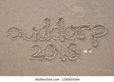 Ouddorp 2018 written in sand on the beach of Ouddorp, Goeree Overflakkee, The Netherlands