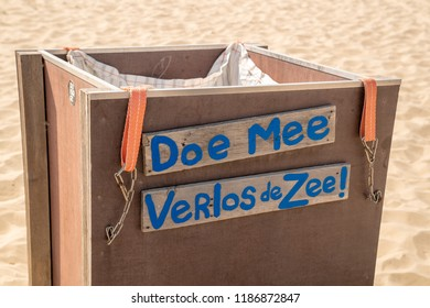 Ouddorp / Holland - Aug. 7, 2018: Join. Save the sea! Translation of message in Dutch on a garbage bin on the beach of Ouddorp, Goeree Overflakkee, The Netherlands.