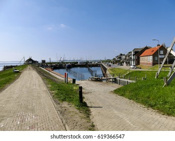 Ouddorp, The Netherlands - April 9, 2017: Old little harbor scenery at Ouddorp on a sunny day, Goeree overflakkee