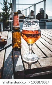 Ouddorp / The Netherlands - februari 3 2019: Enjoying a Brand IPA beer and some snacks on spring afternoon at the beach