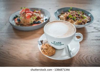 Ouddorp / The Netherlands - March 11 2019: Café Intención Ecológico Fairtrade coffee with healthy breakfast