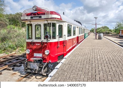 Ouddorp, The Netherlands, May 4, 2019: classic red and white tram at a platform on the historic RTM museum line