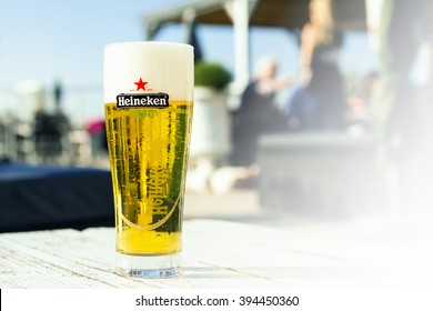 OUDDORP, NETHERLANDS- OCTOBER 10, 2015: A glass of heineken beer on the table of a beachclub.