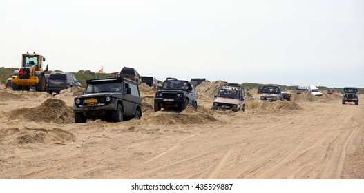 OUDDORP,NETHERLANDS 12/06/2016;This 4 x 4 beach event takes place in Ouddorp. A large beach with a track made by bulldozers and jeeps so everyone can drive there 4x4 through this sandy hill course