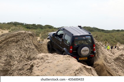 OUDDORP,NETHERLANDS ??12/06/2016;This 4 x 4 beach event takes place in Ouddorp. A large beach with a track made by bulldozers and jeeps so everyone can drive there 4x4 through this sandy hill course