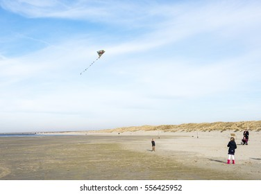 OUDDORP,NETHERLANDS - MARCH 07 2015:Unidentified kids having fun with kiting on the beach in Ouddorp on March 07 2015, ouddorp has the widest beach in Netherlands for kiting and relaxing