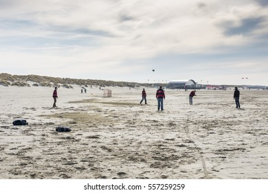 OUDDORP,NETHERLANDS - MARCH 07 2015:Unidentified man playing soccer on the beach in Ouddorp on March 07 2015, ouddorp has the widest beach in Netherlands for relax and vcation