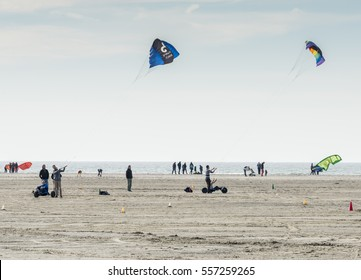 OUDDORP,NETHERLANDS - MARCH 07 2015:Unidentified man kite surfing on the beach in Ouddorp on March 07 2015, ouddorp has the widest beach in Netherlands for kitesurfing