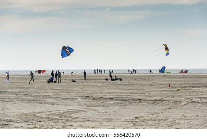 OUDDORP,NETHERLANDS - MARCH 07 2015:Unidentified people having fun with kitesurfing and surfing on the beach in Ouddorp on March 07 2015, ouddorp has the widest beach in Netherlands for kitesurfing