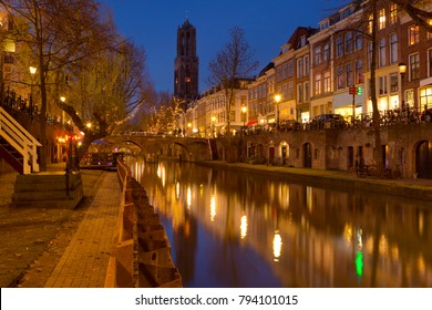 The Oudegracht canal and Dom church in Utrecht in The Netherlands at night.