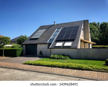 Oudenburg, Belgium - 29 June 2019: typical european houses villas in green surroundings with implementation of photovoltaic solar panels on the roofs