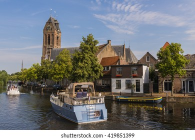 Oudewater, The Netherlands - July 22, 2014: Two motorboats on the Hollandse IJssel.