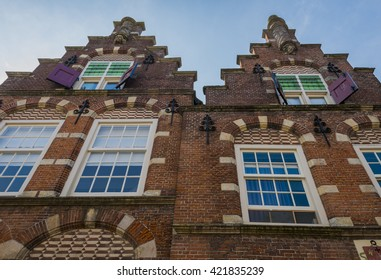 Oudewater, The Netherlands - July 22, 2014: Step-roof of two houses in the town in the province of Utrecht.