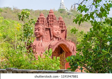 Oudong, Cambodia - April 10, 2018: Gopuram or gopura,  a monumental entrance tower adorned  with gigantic stone faces  in the Vipassana Dhura Buddhist Meditation Center