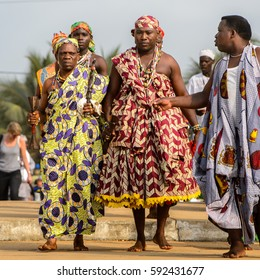 OUIDAH, BENIN - Jan 10, 2017: Unidentified Beninese people in national suits walk at the voodoo festival, which is anually celebrated on January, 10th.