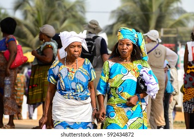 OUIDAH, BENIN - Jan 10, 2017: Unidentified Beninese woman in national suit wears necklace and earings at the voodoo festival, which is anually celebrated on January, 10th.