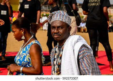 OUIDAH, BENIN - Jan 10, 2017: Unidentified Beninese old man with mustaches in national suit wears necklace at the voodoo festival, which is anually celebrated on January, 10th.