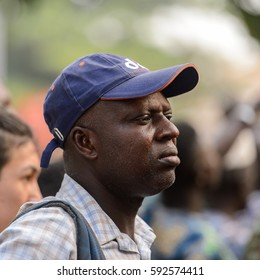 OUIDAH, BENIN - Jan 10, 2017: Unidentified Beninese man in shirt and a cap seriously looks ahead at the voodoo festival, which is anually celebrated on January, 10th.