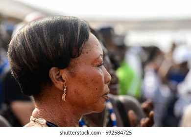 OUIDAH, BENIN - Jan 10, 2017: Unidentified Beninese woman wears necklace and earings at the voodoo festival, which is anually celebrated on January, 10th.