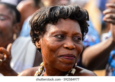 OUIDAH, BENIN - Jan 10, 2017: Unidentified Beninese woman wears necklace and smiles at the voodoo festival, which is anually celebrated on January, 10th.