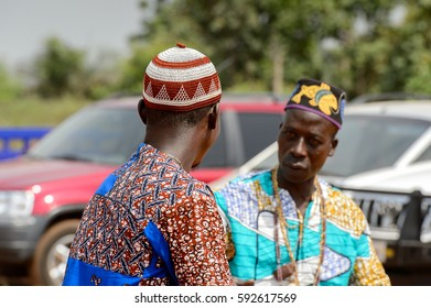 OUIDAH, BENIN - Jan 10, 2017: Unidentified Beninese man in colored clothes wears necklace at the voodoo festival, which is anually celebrated on January, 10th.