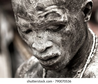 Ouidah, Benin – January 10, 2012: Voodoofestival - Man is in a trance of the rhythm of the drums and has oil and white powder on his face.