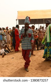 Ouidah Benin January 10 2015 Voodoo festival at the beach. Man blows on a traditional flute to the dancers and singers