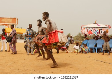 Ouidah, Benin, January 10 2015 Voodoo festival on the beach. Dancers are dancing to pray to the gods