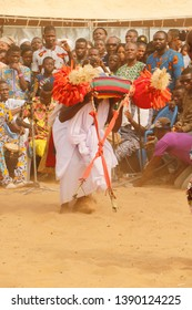 Ouidah, Benin January 10 2015 Voodoo festival A man in white clothes dances while he is in trance