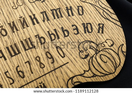 A Ouija Board Yellow On Black Background