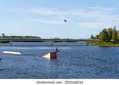 Oulu, Finland - 25 July, 2021: wakeboarder having fun in the wakepark in downtown Oulu on a beautiful summer day