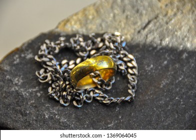 Oulu, Finland, 4.14.2019 The One Ring from The Lord Of The Rings. Gold ring in silver chain.