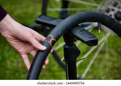 Oulu, Finland 7.13.2019 Patching a broken bike tire.