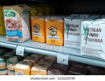 OULU, FINLAND - APRIL 13, 2018: Products displayed for sale on a supermarket shelf: Myllarin wheat flour, Kainuun talkkunaa and Pietolan puuro talkkunaa.
