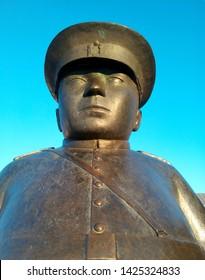 "OULU, FINLAND - APRIL 9, 2018: Close up of the ""Toripolliisi"" bronze sculpture by Kaarlo Mikkonen."