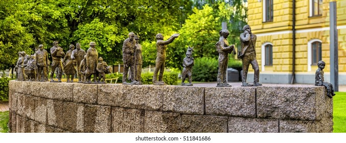 OULU, FINLAND - JULY 06, 2016:  Sanna Koivisto's bronze sculpture  Passage of Time depicts people from different centuries who have contributed to the success of the city. Maria Silfvan's Park, Oulu.