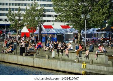 Oulu, Finland - July 11 2016:  People enjoying sunshine near the harbour in Oulu city center in polar day