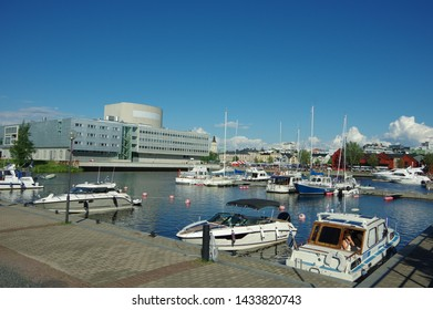 Oulu, Finland - July 11 2016: Harbour, yachts, sailboats and Oulu City Library in Finland summer