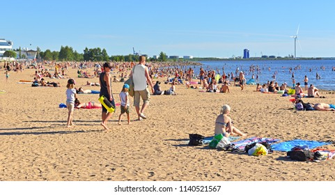OULU, FINLAND - JULY 11, 2018: People rest on Nallikari beach. Baltic Sea