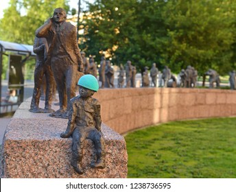 OULU, FINLAND - JULY 11, 2018: Bronze sculpture by Sanna Koivisto entitled Passage of Time (Course of time). Figures depict development of Oulu from 17th century to present day. Boy Marti in blue cap
