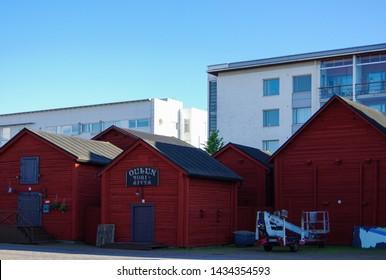 Oulu, Finland - July 12 2016: Red wood barns in city center. Oulun Tori-aitta.
