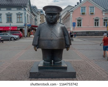 Oulu, Finland - July 26, 2018: Image of the Topolliisi a bronze statue of a policeman, made by the sculptor Kaarlo Mikkonen.