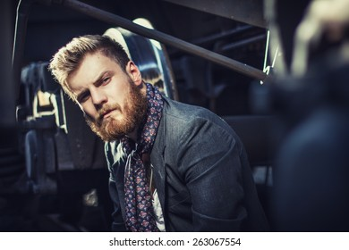 oung handsome attractive bearded model man in urban context