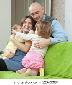 ouple together with two their children at home interior