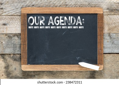 Our agenda sign. Our agenda sign on chalkboard