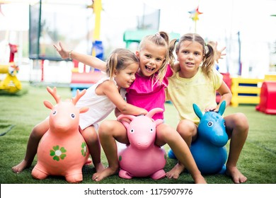 Our childhood is full of smile. Three little girls playing in playground. Space for copy.