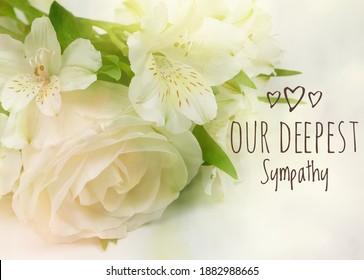 Our Deepest Sympathy card. Soft focus pastel flower bouquet cream background
