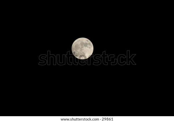 our full moon at night against a black sky
