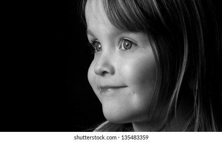 Our hope, a black and white portrait of a young happy healthy bright girl.