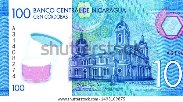 Our Lady of the Assumption Cathedral in Granada. Portrait from Nicaragua 100 Cordobas 2014 Banknotes. An Old paper banknote, vintage retro. Famous ancient Banknotes. Collection.